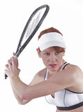 Caucasian woman plays racquetball. A caucasian woman plays racquetball.  Isolated on white Royalty Free Stock Photo