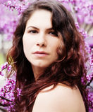 Caucasian Woman Portrait Among Red Bud Blossoms Stock Photography