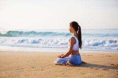 Free Caucasian Woman Practicing Yoga At Seashore Of Tropic Ocean Royalty Free Stock Image - 97046616