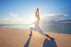 Caucasian woman practicing yoga royalty free stock image