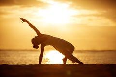 Caucasian woman practicing yoga at seashore Royalty Free Stock Photography