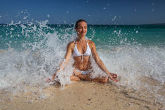 Caucasian woman practicing yoga at seashore royalty free stock photo