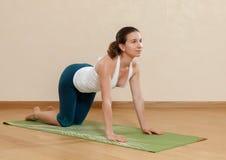 Caucasian woman is practicing yoga stock photos