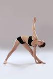 Caucasian woman is practicing yoga . In studio.  grey background Stock Photo