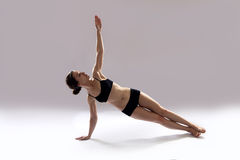 Caucasian woman is practicing yoga . In studio.  grey background Stock Photography