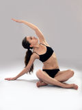 Caucasian woman is practicing yoga . In studio.  grey background Stock Images