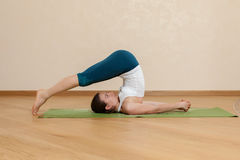 Caucasian woman is practicing yoga Royalty Free Stock Image