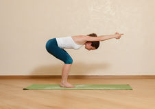 Caucasian woman is practicing yoga at studio Royalty Free Stock Images