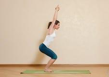 Caucasian woman is practicing yoga at studio Stock Images
