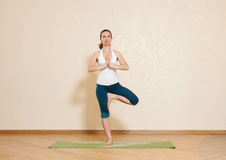Caucasian woman is practicing yoga at studio Royalty Free Stock Photo