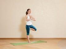 Caucasian woman is practicing yoga at studio Stock Photo