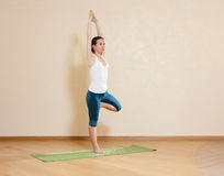 Caucasian woman is practicing yoga Royalty Free Stock Photo