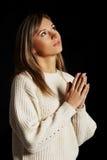 Caucasian woman praying Royalty Free Stock Photos