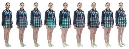 Photo girl during pregnancy in plaid shirt. Caucasian woman during pregnancy in plaid shirt on white background royalty free stock images