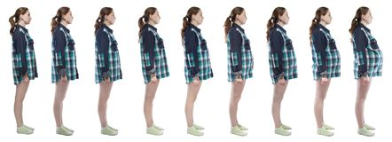 Photo young girl during pregnancy in plaid shirt. Caucasian woman during pregnancy in plaid shirt on white background royalty free stock image