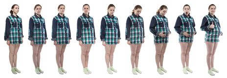 Woman during pregnancy with different emotions. Caucasian woman during pregnancy in plaid shirt on white background royalty free stock photography