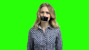 Caucasian woman protester with tape on mouth. Female activist protesting on Chroma Key background. Conceptual image for banned speech stock video