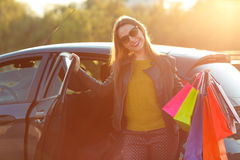 Caucasian woman putting her shopping bags into the car Royalty Free Stock Photo