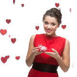 Caucasian woman in red dress holding gift Royalty Free Stock Photos