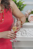 Caucasian woman in red dress holding a glass of champagne closeu Stock Image