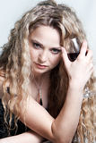 Caucasian woman with a red wine glas Stock Images