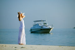 Caucasian woman rests at beautiful seashore Stock Photos