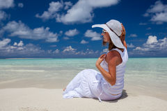 Caucasian woman rests at beautiful seashore Stock Image