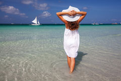 Caucasian woman rests at seashore Royalty Free Stock Photo