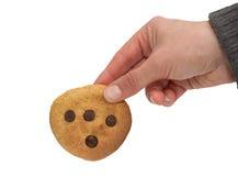 Pumpkin cookie and hand Stock Photos