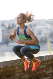 Caucasian woman runner jogger jumping Stock Image