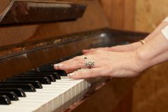 A caucasian woman's hand playing piano Stock Photos