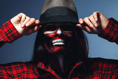 Caucasian woman with scary halloween face art looking at camera. In studio Royalty Free Stock Image