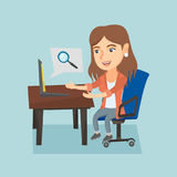 Caucasian woman searching information on a laptop. Young caucasian business woman working on her laptop in office and searching information through the internet Royalty Free Stock Image