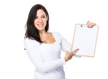 Caucasian woman show with clipboard Royalty Free Stock Photography