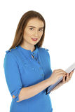 Caucasian woman show with clipboard. Sexy young woman in blue dress, Caucasian brunette show with clipboard, isolated on white background Stock Photo
