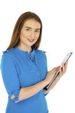 Caucasian woman show with clipboard. Sexy young woman in blue dress, Caucasian brunette show with clipboard, isolated on white background Royalty Free Stock Images