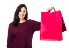 Caucasian woman show with shopping bag Stock Photography