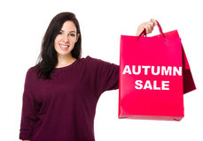 Caucasian woman show with shopping bag and showing autumn sale Royalty Free Stock Photography
