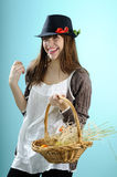 Caucasian woman showing easter basket. Teenager girl with black hat showing egg from easter basket Stock Photos
