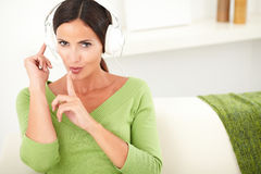 Caucasian woman showing a silence sign Stock Image