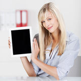 Caucasian woman shows tablet Stock Photography