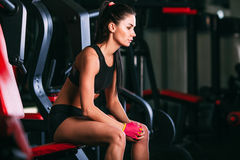 Caucasian woman sittingon shoulder press machine. Caucasian woman sitting on shoulder press machine in gym stock photo