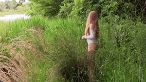 Caucasian Woman Standing In White Leotard On River Bank stock footage