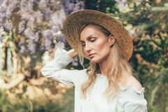 Caucasian woman in a straw boater hat royalty free stock photography