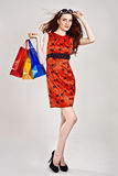 Caucasian woman in stylish dress with shopping ba Stock Photo