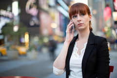 Caucasian woman talking on cellphone Royalty Free Stock Photo