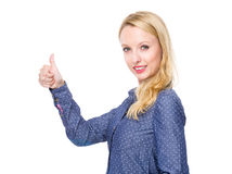 Caucasian woman with thumb up Stock Images