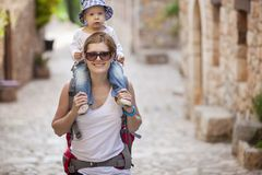 Caucasian woman tourist carrying her little son Stock Photos