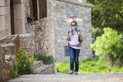 Caucasian woman tourist carrying her little son Stock Photography