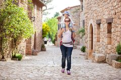 Caucasian woman tourist carrying her little son Royalty Free Stock Photos